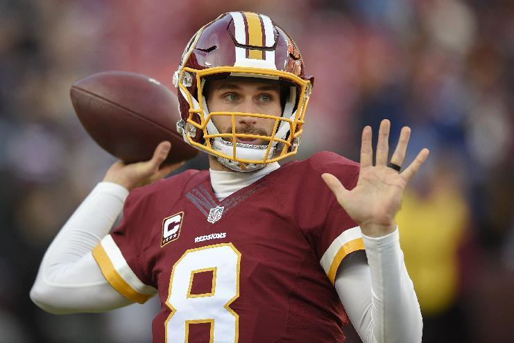 In this photo taken Jan. 1, 2017, Washington Redskins quarterback Kirk Cousins (8) warms up before an NFL football game against the New York Giants in Landover, Md. Cousins' agent says the Washington Redskins' quarterback has signed his contract for the exclusive franchise tag. (AP Photo/Nick Wass)
