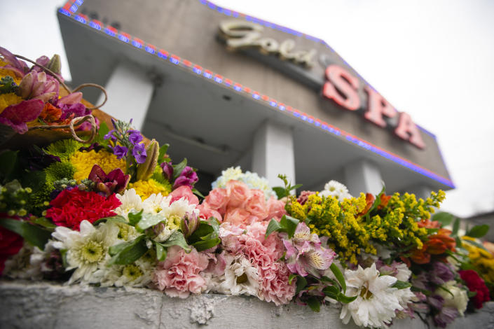 Flowers seen outside Gold Spa, one of the Atlanta-area spas targeted in a shooting spree that left eight people, including six Asian women, dead on Tuesday, March 16, 2021. (Elijah Nouvelage for The Washington Post via Getty Images)