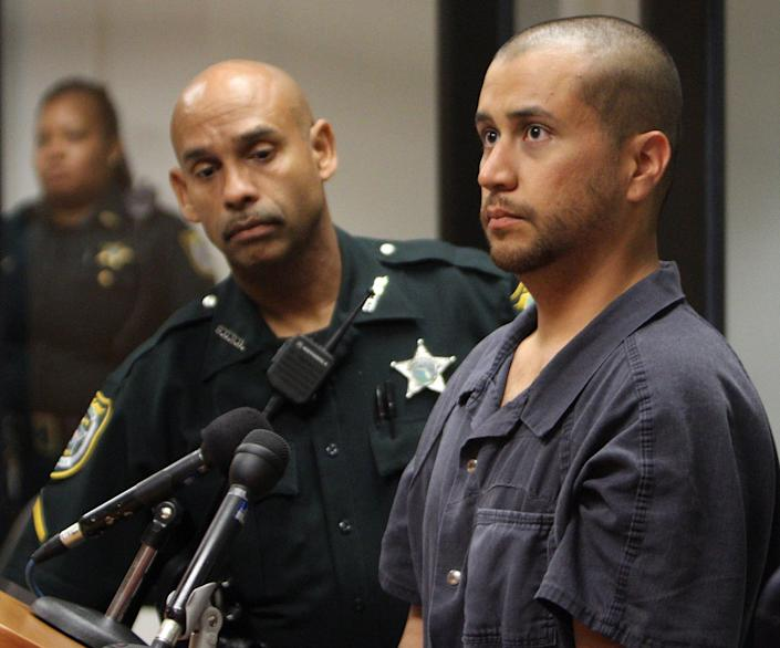 FILE - In this Thursday, April 12, 2012 file photo, George Zimmerman, charged with killing 17-year-old Trayvon Martin, right, stands next to a Seminole County Deputy during a court hearing in Sanford, Fla. A judge on Friday, June 1, 2012 revoked Zimmerman's bond and ordered him returned to jail within 48 hours. Circuit Judge Kenneth Lester said Zimmerman misled the court about how much money he had available when his bond was set for $150,000 in April. Prosecutors claim Zimmerman had $135,000 available that had been raised by a website he set up. (AP Photo/Gary W. Green, Orlando Sentinel, Pool)
