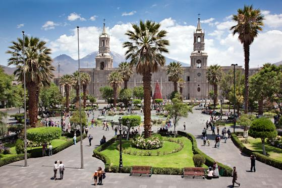 Arequipa Cathedral dominates the main square, Plaza de Armas, in Arequipa, Peru. It is built with sillar, a stone mined from the extinct Chachani volcano.