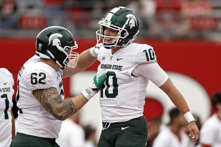Michigan State quarterback Payton Thorne (10) celebrates a touchdown with Luke Campbell (62) during the first half of an NCAA college football game against Rutgers, Saturday, Oct. 9, 2021, in Piscataway, N.J. (AP Photo/Adam Hunger)