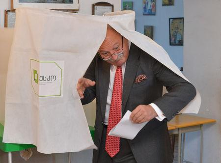 Grigol Vashadze, presidential candidate from the opposition United National Movement, leaves a voting booth at a polling station during presidential election in Kutaisi, Georgia October 28, 2018. REUTERS/Tornike Turabelidze