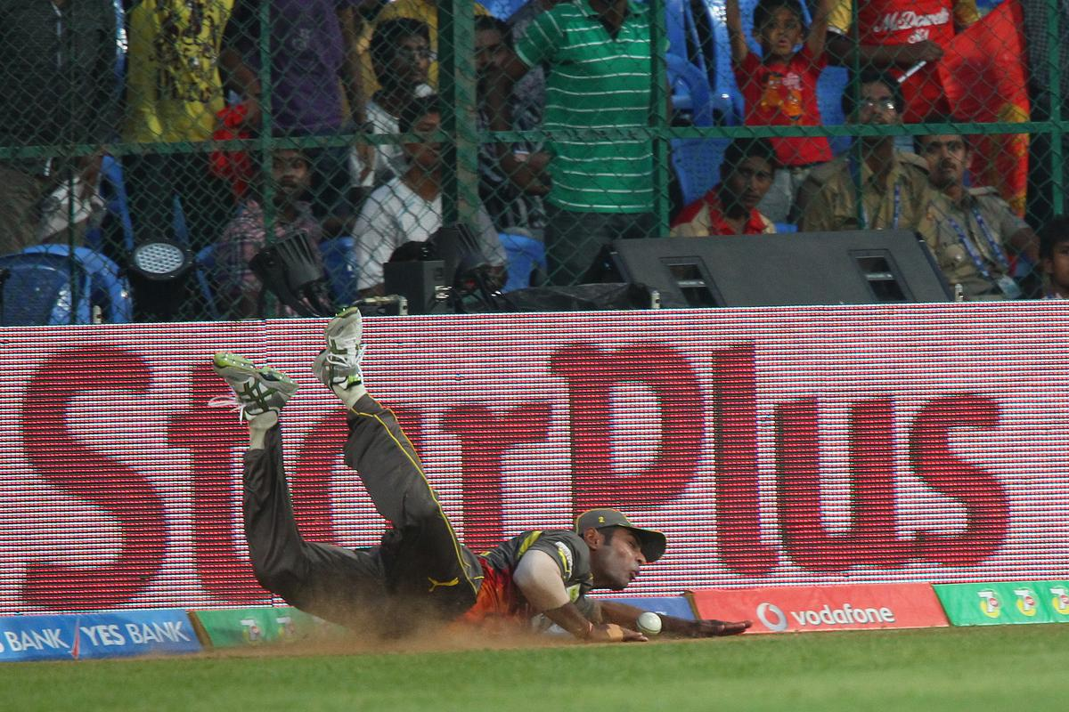 Ashish Reddy saves the four during match 9 of of the Pepsi Indian Premier League between The Royal Challengers Bangalore and The Sunrisers Hyderabad held at the M. Chinnaswamy Stadium, Bengaluru on the 9th April 2013..Photo by Ron Gaunt-IPL-SPORTZPICS  ..Use of this image is subject to the terms and conditions as outlined by the BCCI. These terms can be found by following this link:..https://ec.yimg.com/ec?url=http%3a%2f%2fwww.sportzpics.co.za%2fimage%2fI0000SoRagM2cIEc&t=1493536433&sig=PYkO3lqmzGSk84zXekcKLw--~C