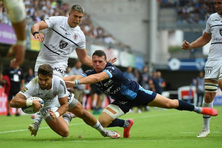Lucas Tauzin scored Toulouse's second try in a 17-15 win over Montpellier that puts them three points clear at the top of the Top 14 table (AFP/Sylvain THOMAS)