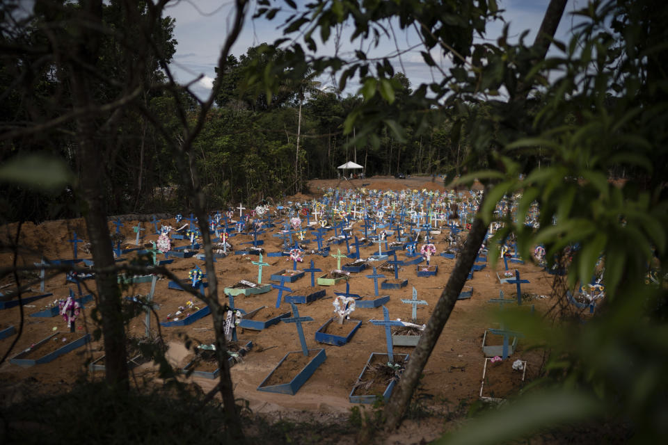 Graves of people who died in the past 30 days fill a new section of the Nossa Senhora Aparecida cemetery, amid the new coronavirus pandemic in Manaus, Brazil, Monday, May 11, 2020. The new section was opened last month to cope with a sudden surge in deaths. (AP Photo/Felipe Dana)