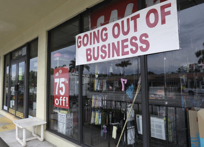"""A store with a """"Going out of Business,"""" sign is shown, Thursday, April 30, 2020, in North Miami Beach, Fla. As of Tuesday, the state said it received unemployment claims from more than 824,000 Floridians and had sent checks to nearly half of them, while about 263,000 of them have been rejected. (AP Photo/Wilfredo Lee)"""