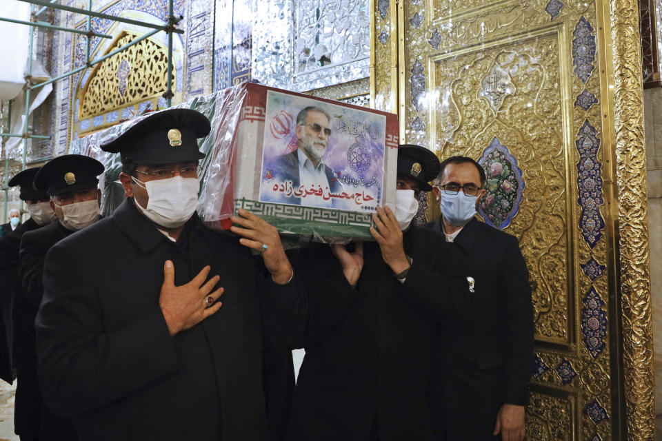 In this picture released by the Iranian Defense Ministry and taken on Saturday, Nov. 28, 2020, caretakers from the Imam Reza holy shrine, carry the flag draped coffin of Mohsen Fakhrizadeh, an Iranian scientist linked to the country's disbanded military nuclear program, who was killed on Friday, during a funeral ceremony in the northeastern city of Mashhad, Iran. An opinion piece published by a hard-line Iranian newspaper has suggested that Iran must attack the Israeli port city of Haifa if Israel carried out the killing of a scientist. (Iranian Defense Ministry via AP)