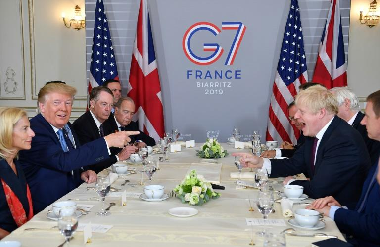 UK Prime Minister Boris Johnson and US President Donald Trump were on obviously friendly terms as they sat down for a working breakfast (AFP Photo/Nicholas Kamm)