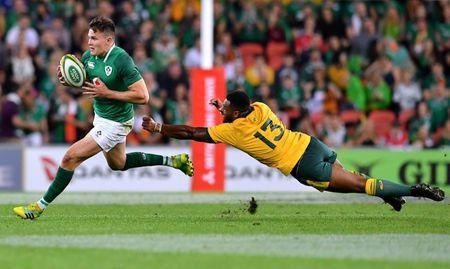Rugby Union - June Internationals - Australia vs Ireland - Lang Park, Brisbane, Australia - June 9, 2018 - Jacob Stockdale of Ireland runs away from a diving Samu Kerevi of Australia. AAP/Darren England/via REUTERS