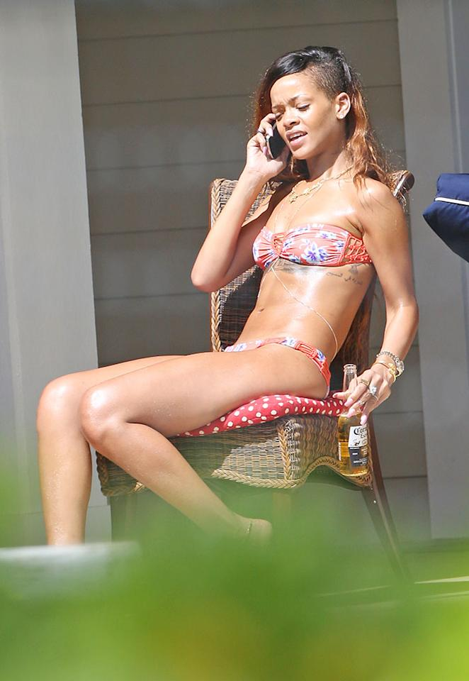 EXCLUSIVE: Rihanna shows off her bikini body as she chills out with a beer by the pool in Hawaii on February 22, 2013. The sexy singer celebrated her birthday with on-off boyfriend Chris Brown and friends on Oahu.