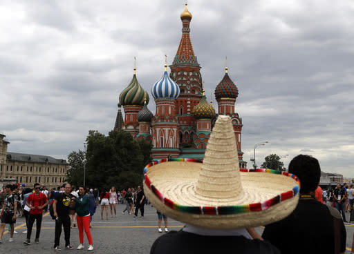 A supporter from Mexico looks at the Saint Basil's Cathedral on the Red Square during the 2018 soccer World Cup in Moscow, Russia, Thursday, June 21, 2018. (AP Photo/Darko Bandic)