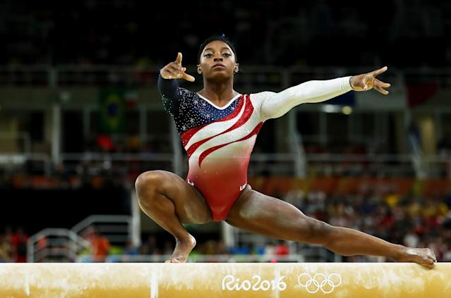 """<a class=""""link rapid-noclick-resp"""" href=""""/olympics/rio-2016/a/1112764/"""" data-ylk=""""slk:Simone Biles"""">Simone Biles</a> led the Americans to Olympic team gold. (Getty Images)"""