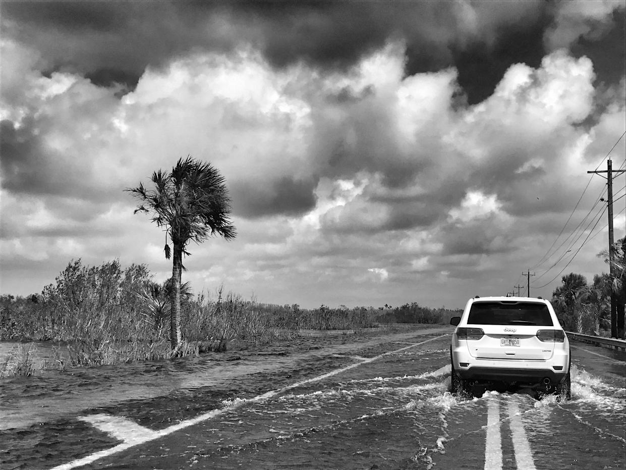 An SUV navigates a flooded road in the aftermath of Hurricane Irma in Ochopee, Fla. (Photo: Holly Bailey/Yahoo News)