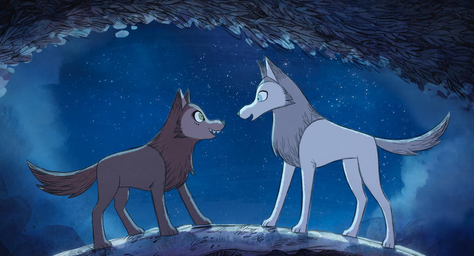 """CORRECTS LEFT - RIGHT POSITION - This image released by Apple shows Robyn Goodfellowe, voiced by Honor Kneafsey, right, and Mebh Óg Mactíre, voiced by Eva Whittaker, in a scene from the Oscar nominated animated film """"Wolfwalkers."""" (Apple via AP)"""