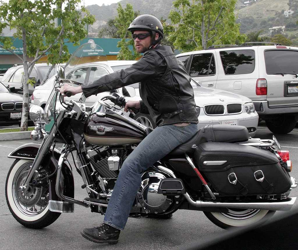 "Jim Carrey's Harley can hold two passengers, but we're not sure that his girlfriend Jenny McCarthy has any interest in messing up her hair under a helmet. <a href=""http://www.x17online.com"" target=""new"">X17 Online</a> - April 4, 2005"