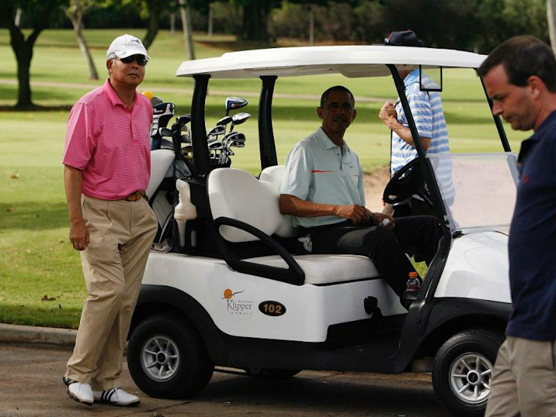 Former prime minister Datuk Seri Najib Razak and former US president Barack Obama get in their golf cart after playing on the 18th green at the Clipper Golf course in Hawaii in this file picture dated December 25, 2014. — Reuters pic