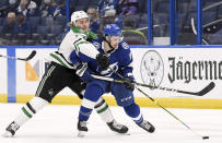 Dallas Stars left wing Roope Hintz (24) and Tampa Bay Lightning center Anthony Cirelli (71) fight for the puck during the second period of an NHL hockey game Friday, May 7, 2021, in Tampa, Fla. (AP Photo/Jason Behnken)