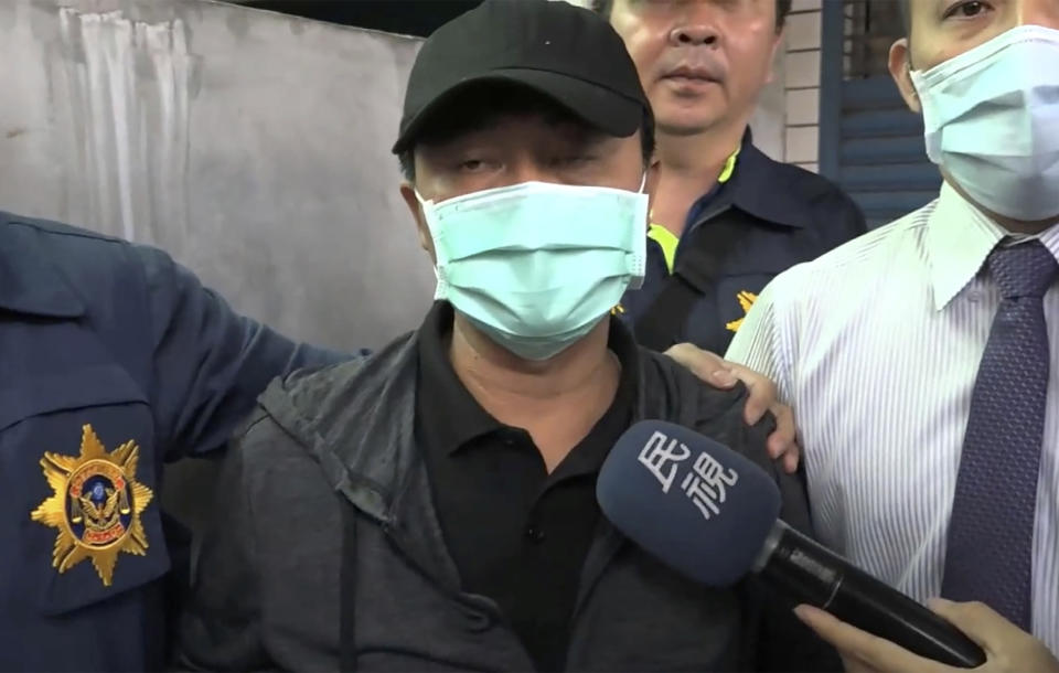 Truck driver Lee Yi-hsiang apologised for the train accident.