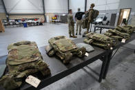 """The new generation of the """"modular scalable vest,"""" are seen as members of the 82nd Airborne Division begin receiving the body armor at Fort Bragg, N.C., Wednesday, Sept. 22, 2021. The Army for the first time, began handing out armor that now comes in three additional sizes, and can be adjusted in multiple ways to fit better and allow soldiers to move faster and more freely. The so-called """"modular, scalable vest"""" was is being distributed to soldiers at Fort Bragg, N.C., along with new versions of the combat shirt that are tailored to better fit women, with shorter sleeves and a flare at the bottom where it hits their hips. (AP Photo/Gerry Broome)"""