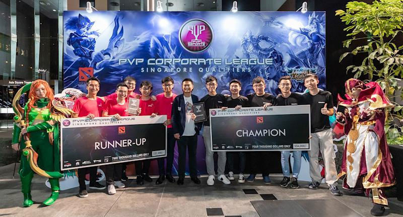 Dota 2 champion DeloitteOne and runner-up PwCSG of the Singapore leg of the PVP Corporate League. (Photo: Singtel)