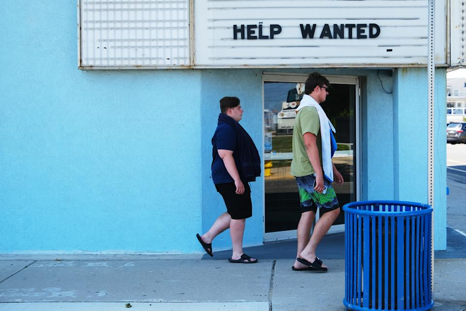 A help wanted sign advertises open jobs outside of a business near the boardwalk days before the Memorial Day weekend in the shore community of Wildwood, New Jersey, on May 27, 2021. (Photo by Spencer Platt/Getty Images)