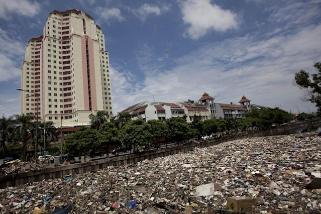 JAKARTA, INDONESIA - JANUARY 26: A view of waste that was piled up by the flood at Pakin river in North Jakarta on January 26, 2013 in Jakarta, Indonesia. With heavy rain forecast for January 26-28, Indonesian authorities have organised the use of generators and cloud-seeding measures to defuse rain-laden clouds to help prevent further flooding of Jakarta, following last week's floods which claimed the lives of 32 people. (Photo by Ulet Ifansasti/Getty Images)