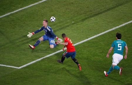 Soccer Football - International Friendly - Germany vs Spain - ESPRIT arena, Dusseldorf, Germany - March 23, 2018 Spain's Rodrigo scores their first goal past Germany's Marc-Andre ter Stegen REUTERS/Wolfgang Rattay