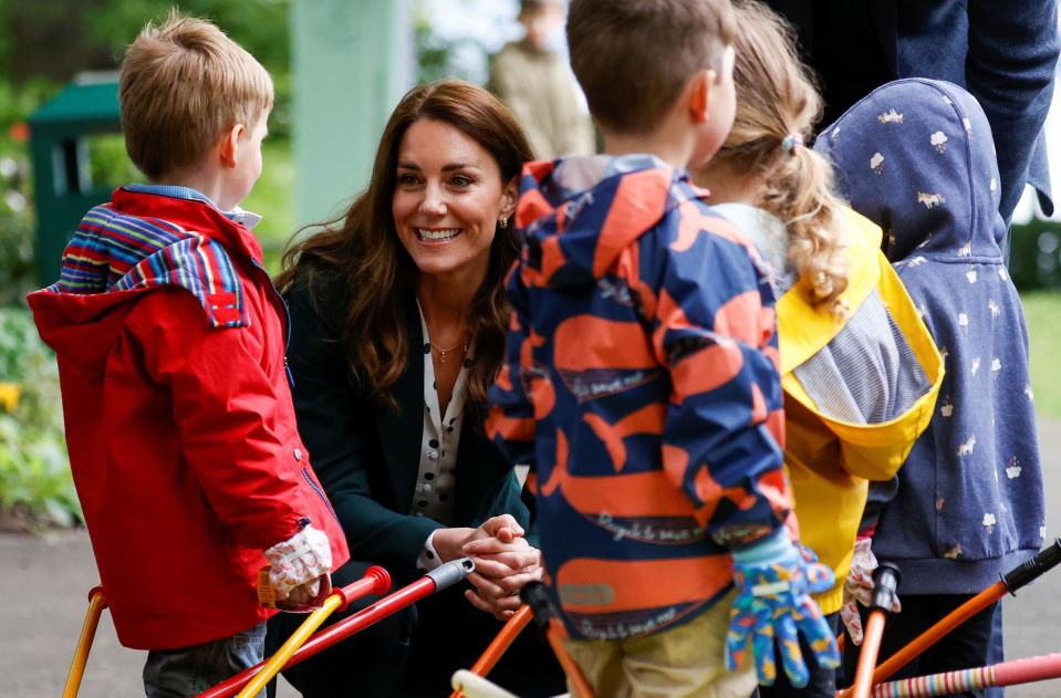 Britain's Catherine, Duchess of Cambridge meets children from Edzell Nursery as she visits Starbank Park to hear about the work of Fields in Trust, along with Britain's Prince William, Duke of Cambridge, in Edinburgh, Scotland on May 27, 2021. (Photo by PHIL NOBLE / POOL / AFP) (Photo by PHIL NOBLE/POOL/AFP via Getty Images)