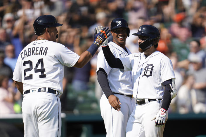 Detroit Tigers' Eric Haase, right, celebrates his three run inside-the-park home run with Miguel Cabrera (24) and Jonathan Schoop, middle in the fourth inning of a baseball game against the Chicago White Sox in Detroit, Saturday, July 3, 2021. (AP Photo/Paul Sancya)