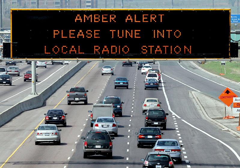 An Amber Alert is displayed on sign over westbound Highway 401 near Keele St. in 2014. (File photo from Jim Wilkes/Toronto Star/Getty Images)