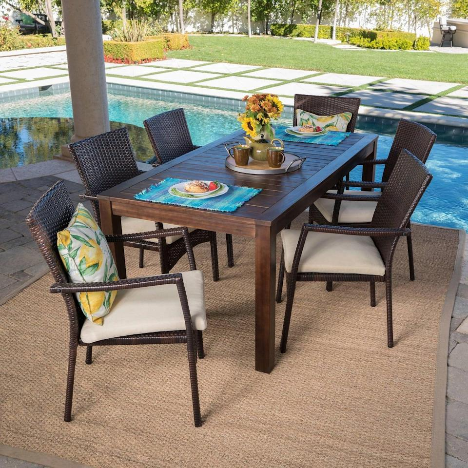 <p>You can't go wrong with the clean and simple design on the <span>Geelong Acacia Wood and Wicker Patio Dining Set</span> ($800).</p>