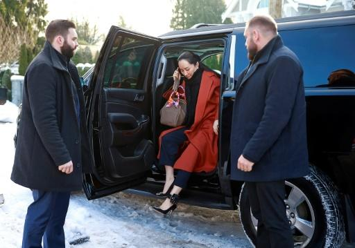 Huawei executive Meng Wanzhou, whom the US has accused of fraud, exits her vehicle at her home after her court appearance on January 17, 2020 in Vancouver, Canada