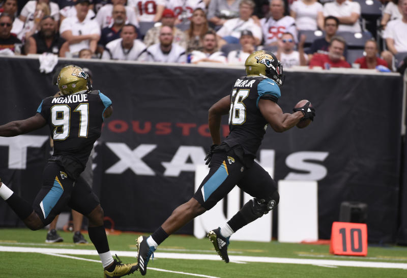 Jacksonville Jaguars defensive end Dante Fowler (56) returns a fumble for a touchdown against the Houston Texans. (AP)