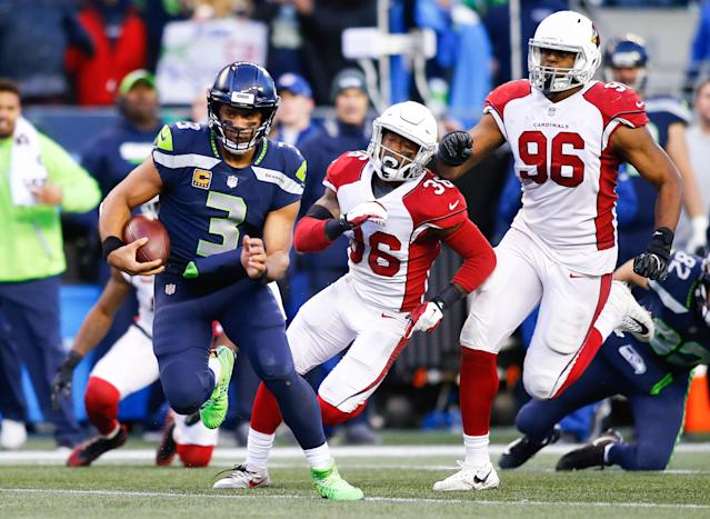 <p>Quarterback Russell Wilson #3 of the Seattle Seahawks rushes for 31 yards in the fourth quarter against the Arizona Cardinals, including Budda Baker #36 and Kareem Martin #96 at CenturyLink Field on December 31, 2017 in Seattle, Washington. (Photo by Jonathan Ferrey/Getty Images) </p>