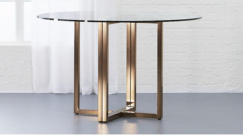 """Get it at <a href=""""https://www.cb2.com/silverado-brass-47-round-dining-table/s593723"""" target=""""_blank"""">CB2, $349</a>."""