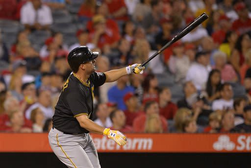 Pittsburgh Pirates' Gaby Sanchez hits a solo home run during the eighth inning of their baseball game against the Los Angeles Angels, Saturday, June 22, 2013, in Anaheim, Calif. (AP Photo/Mark J. Terrill)