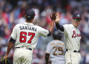 Atlanta Braves first baseman Freddie Freeman gives pitcher Edgar Santana a high-five after Santana closed out the Pittsburgh Pirates during the ninth inning for a victory in a baseball game Sunday, May 23, 2021, in Atlanta. (Curtis Compton/Atlanta Journal-Constitution via AP)