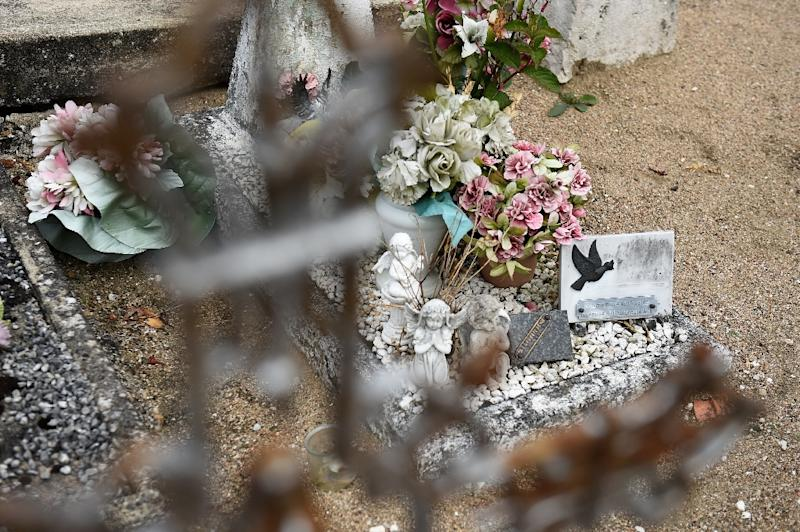"""To this day people regularly replace the flowers on her grave, where the unnamed tombstone reads: """"Here rests an angel"""" (AFP Photo/GUILLAUME SOUVANT)"""