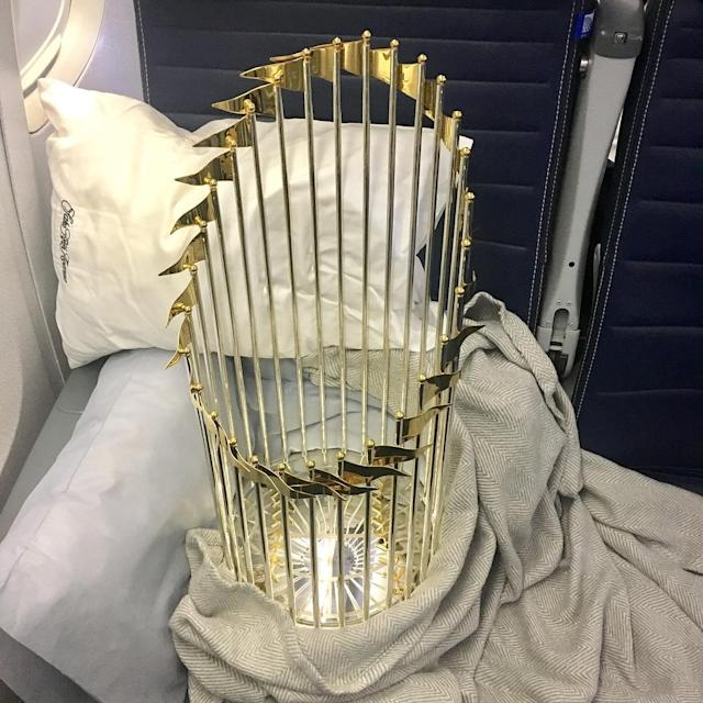 George Springer made sure the Commissioner's Trophy was snug and comfy for the flight from Los Angeles to Houston. (Instagram/@kimberly11ann)