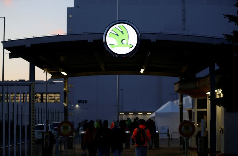 Workers enter Skoda Auto's factory as the company restarts production after shutting down last month due to the coronavirus disease (COVID-19) outbreak in Mlada Boleslav