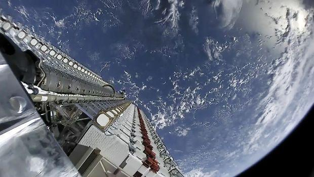 A stack of SpaceX Starlink satellites awaits deployment in low-earth orbit.