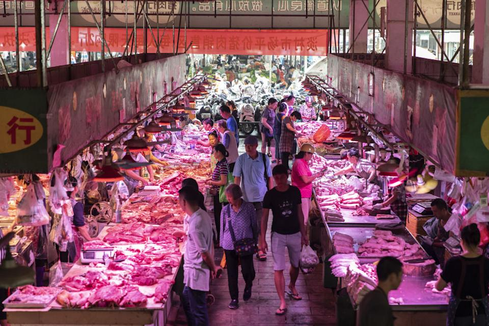 Wet markets are widespread across China and Asia where residents can buy meat, seafood and fresh produce. Pictured is one such market in Nanning, Guangxi. Source: Getty