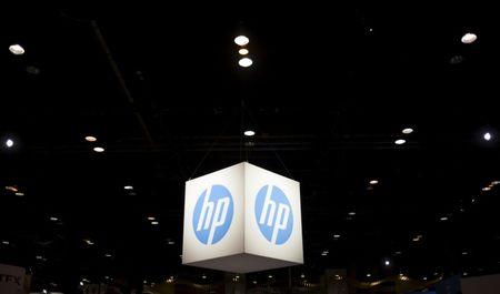 FILE PHOTO: The Hewlett-Packard (HP) logo is seen as part of a display at the Microsoft Ignite technology conference in Chicago, Illinois, May 4, 2015. REUTERS/Jim Young/File Photo
