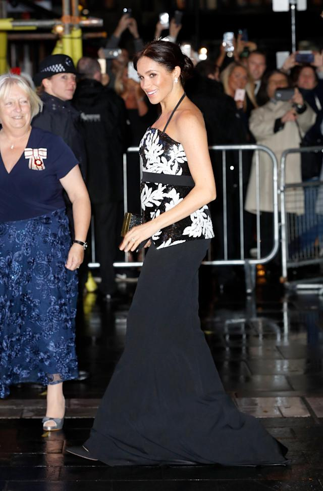 In a boundary-pushing look, the Duchess of Sussex swerved her usual monochrome suit in favour of a sequinned halterneck ensemble by Safiyaa. <em>[Photo: Getty]</em>