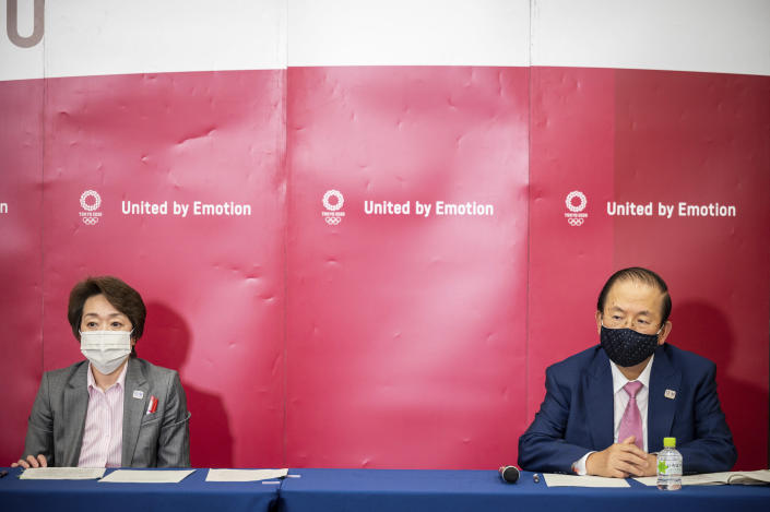 Seiko Hashimoto, president of Tokyo 2020, left, and Toshiro Muto, CEO of Tokyo 2020, attend a media huddle following the IOC Executive Board Meeting at the Tokyo 2020 headquarters in Tokyo, Wednesday, April 21, 2021. (Philip Fong/ Pool Photo via AP)