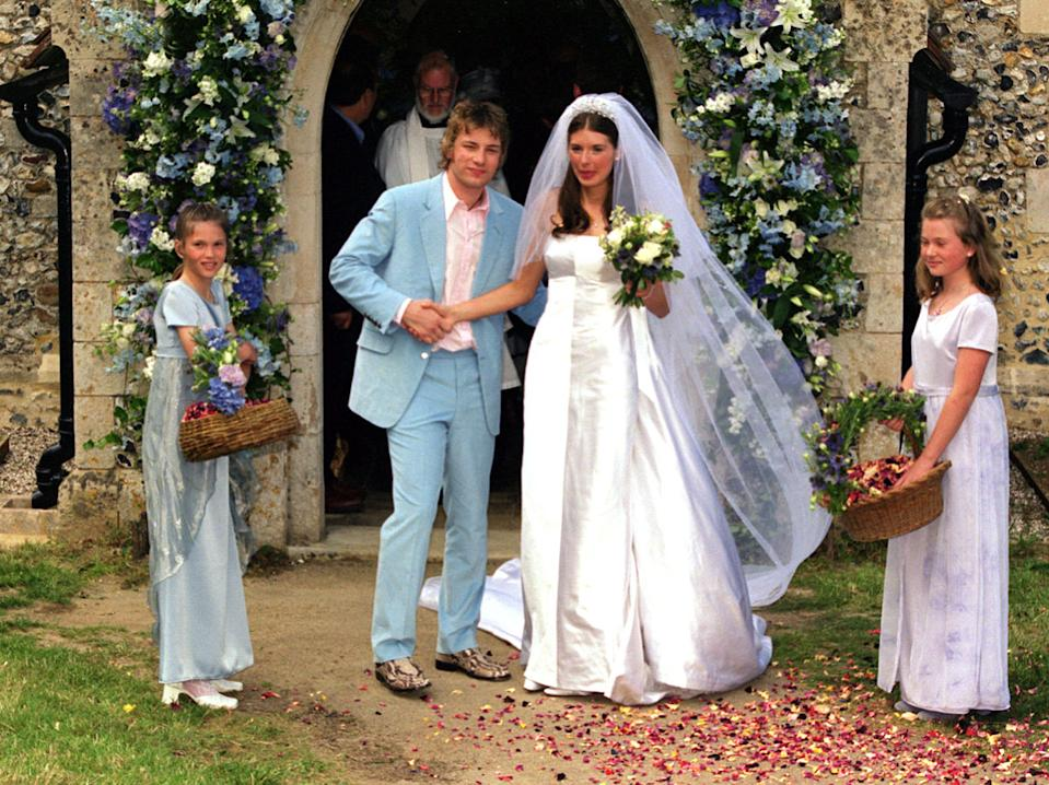 Celebrity television chef Jamie Oliver and his bride Juliette Norton after their wedding ceremony at All Saints Church, Rickling, in Essex. (Photo by William Conran - PA Images/PA Images via Getty Images)