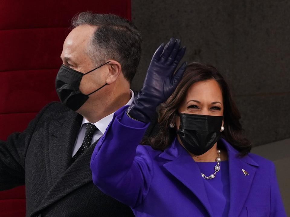 Vice-president elect Kamala Harris and her husband Doug Emhoff wave as they make their entrance to the inaugural ceremony on the West Front of the CapitolREUTERS