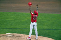 Los Angeles Angels relief pitcher Raisel Iglesias (32) celebrates the Angels' 3-2 win over the Minnesota Twins in a baseball game Thursday, July 22, 2021, in Minneapolis. Iglesias picked up the save. (AP Photo/Jim Mone)
