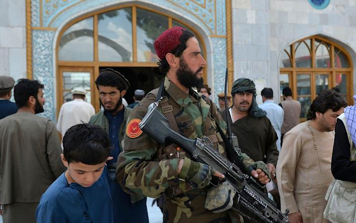 An armed Taliban fighter stands guard at a Mosque in Kabul on September 3 - AFP