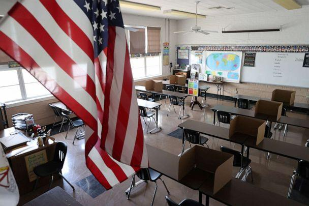 PHOTO: Social distancing dividers for students are seen in a classroom at St. Benedict School, amid the outbreak of the coronavirus disease (COVID-19), in Montebello, near Los Angeles, California, July 14, 2020. (Lucy Nicholson/Reuters)